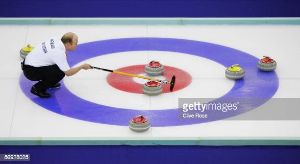 Ewan MacDonald of Great Britain lines up a shot during the Gold medal match of the men's curling between United States and Great Britain during Day...