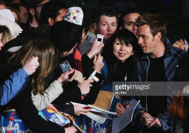 Ewan McGregor is mobbed by fans as he arrives at the UK Premiere of the animated film 'Robots' at Vue Leicester Square on March 14 2005 in London