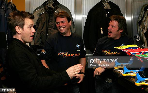 Ewan McGregor talks with Russ Malkin and Charley Boorman at the launch of the Race to Dakar on December 14 2005 in London England Charley Boorman and...