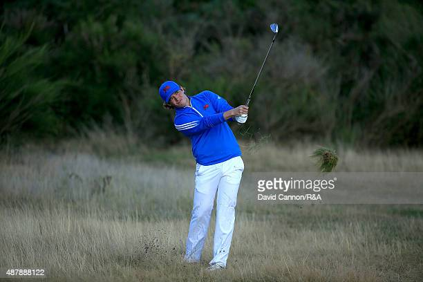 Ewen Ferguson of the Great Britain and Ireland Team plays his fourth shot on the 11th hole in his match against Maverick McNealy of the United States...