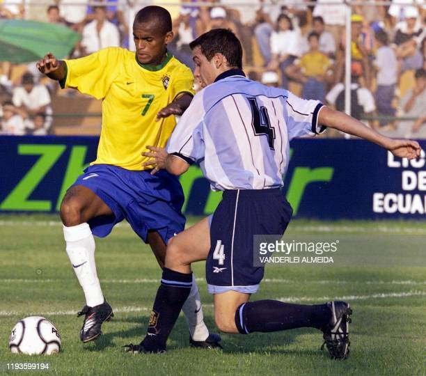 Ewerton Henrique of Brazil and Pablo De Muner of Argentina fight for the ball during a match at the South American Soccer Championships in Portoviejo...