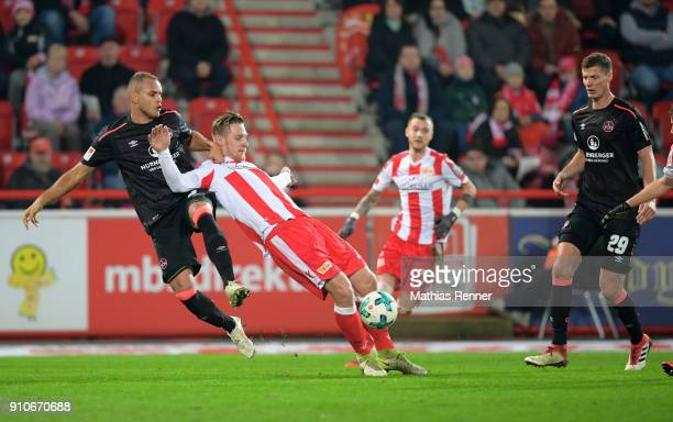 Ewerton of 1 FC Nuernberg Sebastian Polter of 1FC Union Berlin and Patrick Erras of 1 FC Nuernberg during the game between Union Berlin and the 1 FC...