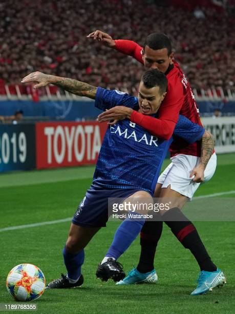 Ewerton of Urawa Red Diamonds and Sebastian Giovinco of Al Hilal compete for the ball during the AFC Champions League Final second leg match between...