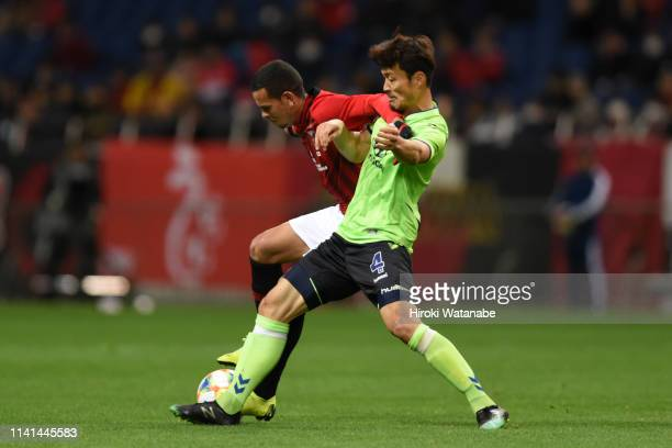 Ewerton of Urawa Red Diamonds and Shin Hyungmin of Jeonbuk Hyundai Motors compete for the ball during the AFC Champions League Group G match between...