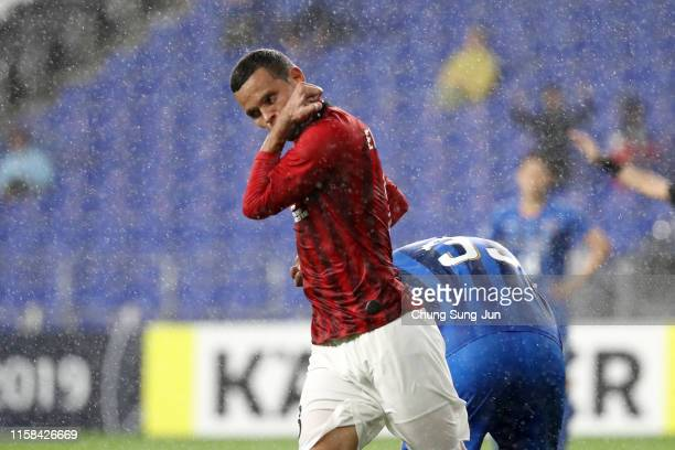 Ewerton of Urawa Red Diamonds celebrates scoring his side's third goal during the AFC Champions League round of 16 second leg match between Ulsan...