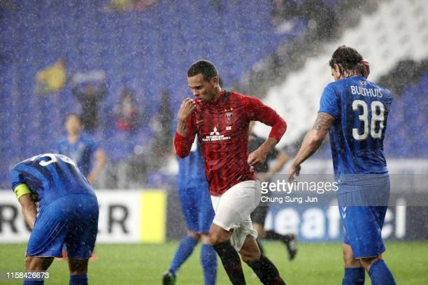 Ewerton of Urawa Red Diamonds celebrates scoring his side's third goal during the AFC Champions League round of 16 second leg match between Ulsan...