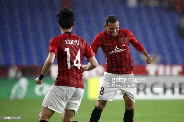 Ewerton of Urawa Red Diamonds celebrates scoring his side's third goal with his team mate Kenyu Sugimoto during the AFC Champions League round of 16...