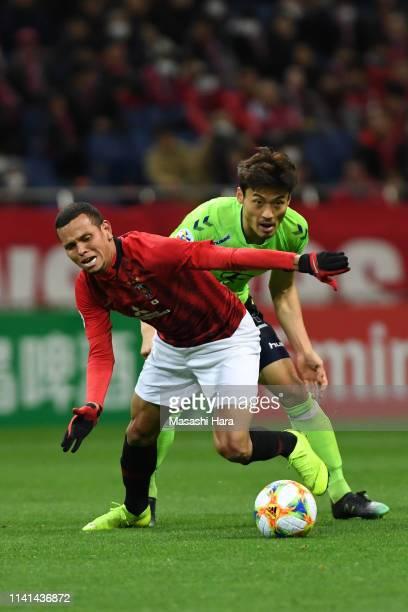 Ewerton of Urawa Red Diamonds controls the ball under pressure of Han Kyowon of Jeonbuk Hyundai Motors during the AFC Champions League Group G match...