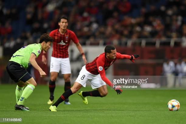 Ewerton of Urawa Red Diamonds is challenged by Shin Hyungmin of Jeonbuk Hyundai Motors during the AFC Champions League Group G match between Urawa...