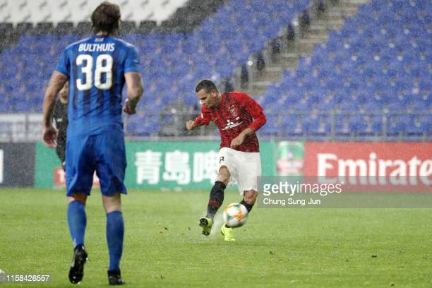 Ewerton of Urawa Red Diamonds scores his side's third goal during the AFC Champions League round of 16 second leg match between Ulsan Hyundai and...