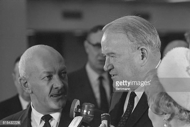Ewing Kauffman, new owner of the Kansas City baseball franchise, listens as Joe Cronin, American League president announces the selection of...