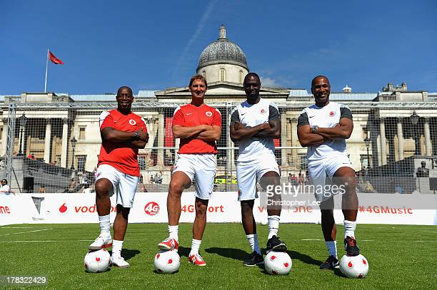 Ex Arsenal Legend's Ian Wright and Tony Adams with Ex Tottenham Hotspur Legends Ledley King and Les Ferdinand pose for the camera during the Vodafone...