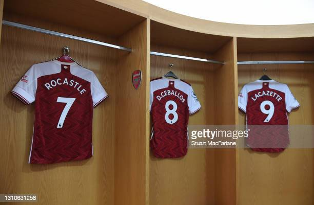 Ex Arsenal player David Rocastle's shirt hangs with the shirts of current players Dani Ceballos and Alex Lacazette before in the changing room before...