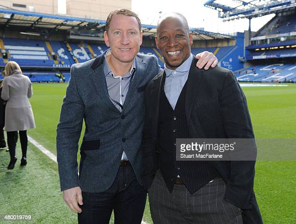 Ex Arsenal players Ray Parlour and Ian Wright before the Barclays Premier League match between Chelsea and Arsenal at Stamford Bridge on March 22...