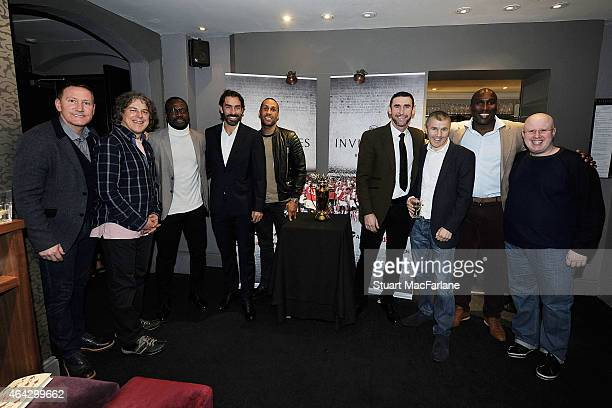 Ex Arsenal players Ray Parlour Lauren Robert Pires Martin Keown and Sol Campbell with comedian Alan Davies boxer James DeGale boxing trainer Jimmy...
