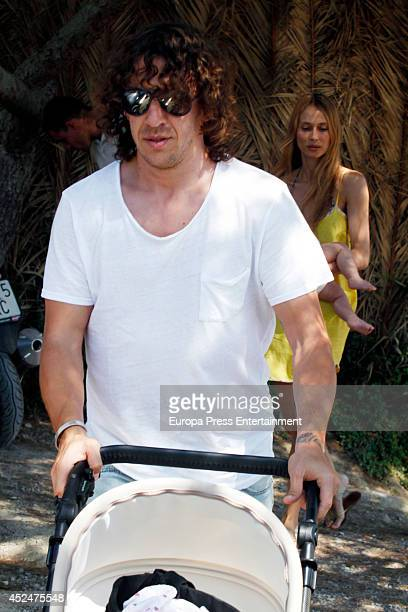 Ex Barcelona football player Carles Puyol his girlfriend Vanessa Lorenzo and their daughter Manuela Puyol are seen on July 21 2014 in Ibiza Spain