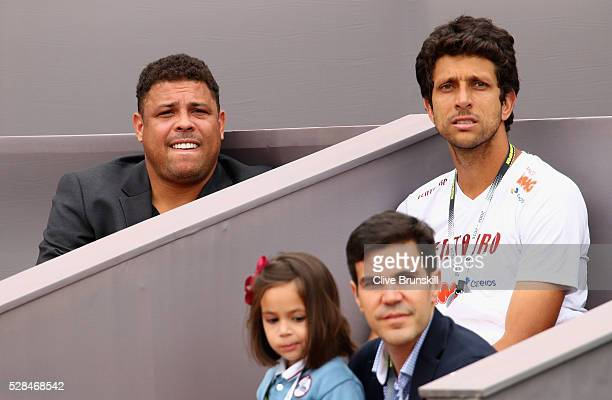 Ex Brazilian and Real Madrid footballer Ronaldo and Brazilian tennis player Marcelo Melo watch Jamie Murray of Great Britain and Bruno Soares of...