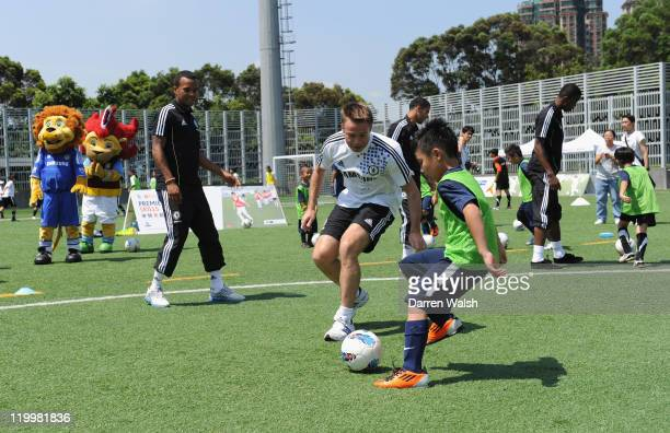 Ex Chelsea player Graeme Le Saux trains children with Nathaniel Chalobah Billy Clifford and Ryan Bertrand of Chelsea during a Barclays Premier League...