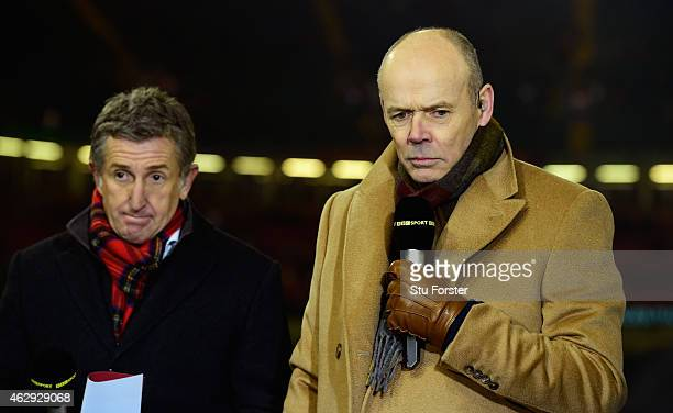 Ex England coach and TV Pundit Clive Woodward and Jonathan Davies look on before the RBS Six Nations match between Wales and England at Millenium...