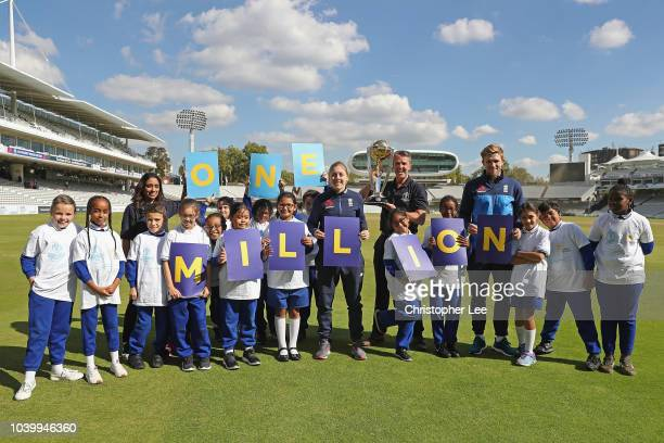 Ex England Cricketer's Isha Guha and Graeme Swann with England International's David Willey and Heather Knight pose with kids and the World Cup...