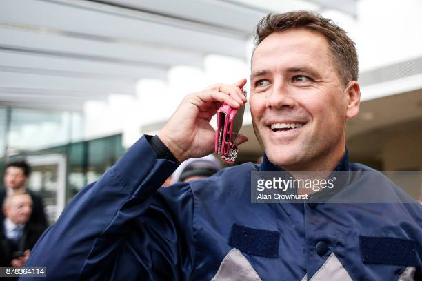 Ex England footballer Michael Owen on the phone prior to riding in a charity race at Ascot racecourse on November 24 2017 in Ascot United Kingdom