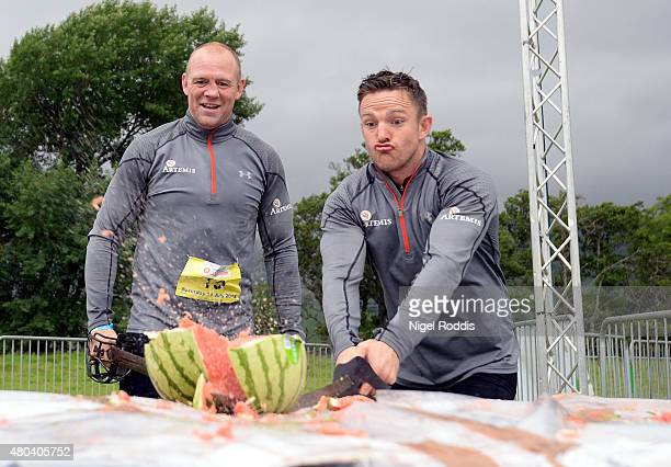 Ex England rugby star Mike Tindall and former Scottish player Rory Lawson, grandson of legendary rugby commentator Bill McLaren, cut a water melon...