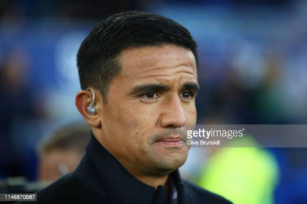 Ex Everton player Tim Cahill now a TV pundit for Sky on the touchline prior to the Premier League match between Everton FC and Burnley FC at Goodison...