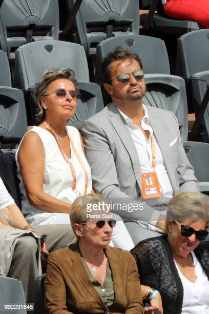 Ex finalist Henri Leconte and fiancee Maria Dowlatshahi are spotted at Roland Garros on June 4 2017 in Paris France