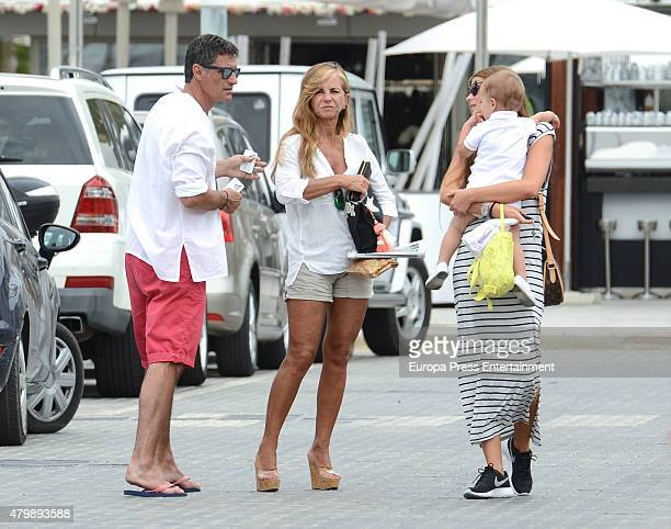 Ex football player Michel his wife Mercedes Morales his daughterinlaw Natalia Coll and his grandson Nicolas Gonzalez are seen on June 11 2015 in...