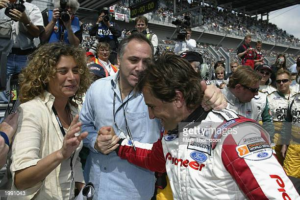 Ex Formula 1 and CART racing driver Alex Zanardi of Italy is congratulated by his wife after driving his specially adapted Champ Car on May 11, 2003...