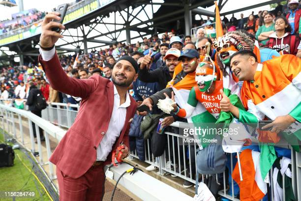 Ex India cricketer Harbhajan Singh takes a selfie with India supporters during the Group Stage match of the ICC Cricket World Cup 2019 between India...