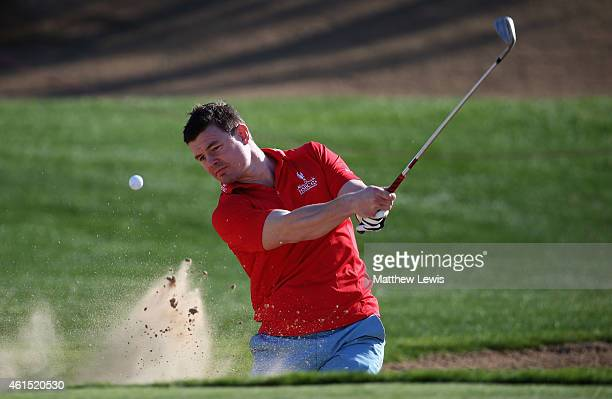 Ex Ireland rugby union player and HSBC Sporting Ambassador Brian O'Driscoll plays out of a bunker during the Pro Am prior to the start of the Abu...