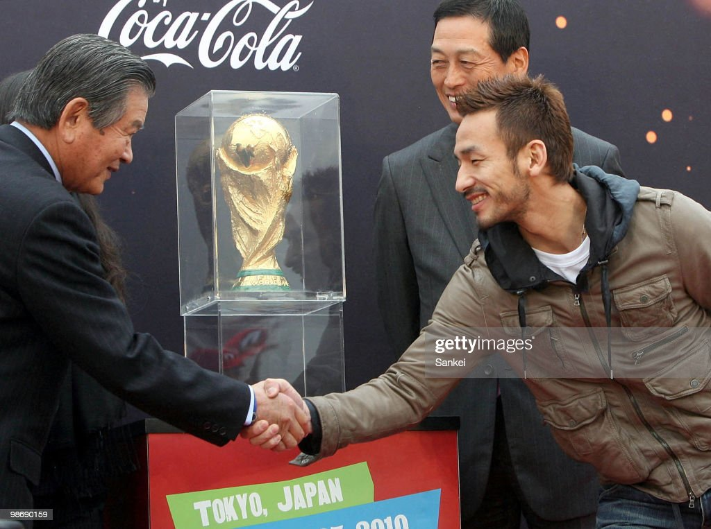 Ex Japanese soccer player Hidetoshi Nakata (R) shakes hands with Japan Football Association Honorary President Saburo Kawabuchi during the FIFA World Cup Trophy Arriaval Ceremony at Tokyo International Airport on April 23, 2010 in Tokyo, Japan.