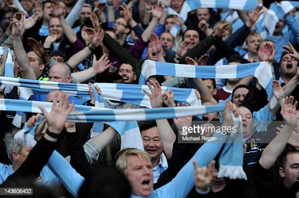Ex Manchester City owner Thaksin Shinawatra looks on from the crowd prior to the Barclays Premier League match between Manchester City and Manchester...