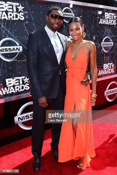 Ex NBA player Roger Mason and Dominique Mason arrived at the BET Make A Wish Foundation Recipients BET Experience At LA Live Red Carpet arrivals...
