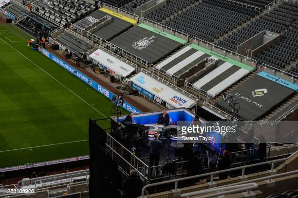 Ex Newcastle player Alan Shearer sits with Gary Lineker in a makeshift studio during the FA Cup Quarter Final match between Newcastle United and...