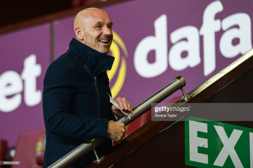 Ex Newcastle United coach Steve Stone laughs during the Premier League match between Burnley and Newcastle United at Turf Moore on October 30, 2017, in Burnley, England.