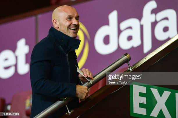 Ex Newcastle United coach Steve Stone laughs during the Premier League match between Burnley and Newcastle United at Turf Moore on October 30 in...