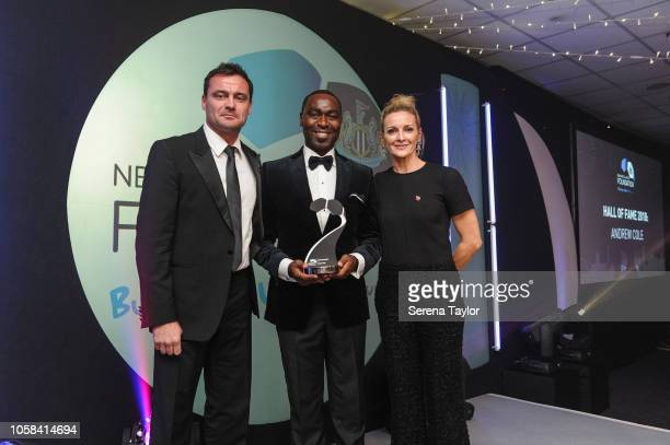 Ex Newcastle United player Andrew Cole poses with Steve Harper and Gabby Logan after he is inducted into the Hall of Fame during the Newcastle United...