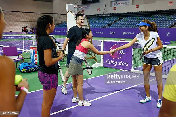 Ex player Iva Majoli and Rising Star Zarina Diyas of Kazakhstan arrive for the Sponsor pro am during day one of the BNP Paribas WTA Finals tennis at...