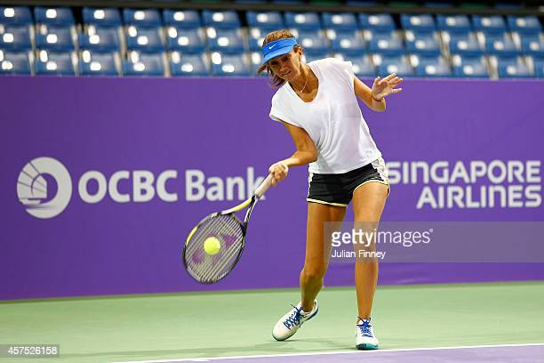 Ex player Iva Majoli warms up before the sponsor pro am during day one of the BNP Paribas WTA Finals tennis at the Singapore Sports Hub on October 20...