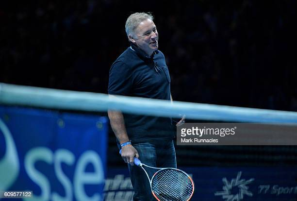 Ex Scottish football player Ally McCoist replaces Andy Murray of Scotland during the doubles match between Andy Murray and Jamie Murray of Scotland...