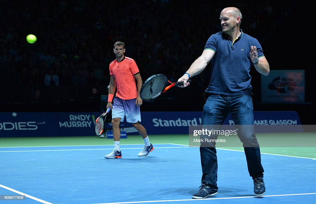 Ex Scottish Rugby player Gregor Townsend (R), replaces Tim Henman of England during the doubles match between Andy Murray and Jamie Murray of Scotland and Tim Henman of England and Grigor Dimitrov of Bulgaria at Andy Murray Live presented by SSE at the SSE Hydro on September 21, 2016 in Glasgow, Scotland.