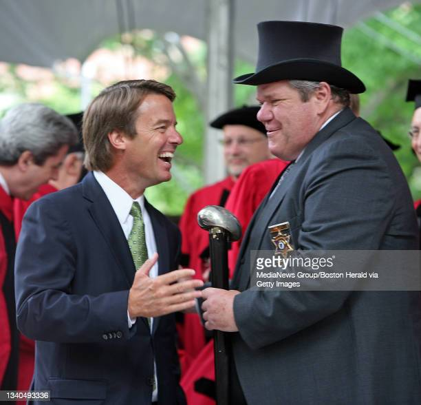 Ex senator and presidential candidate John Edwards has a yuk with Sheriff James V DiPaola at the Harvard University Commencement in Harvard Yard....