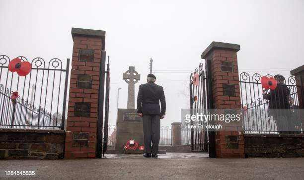 Ex servicemen pay their respects at the Cenotaph on November 08, 2020 in Cefn Fforest, Blackwood, United Kingdom. Remembrance Sunday services are...