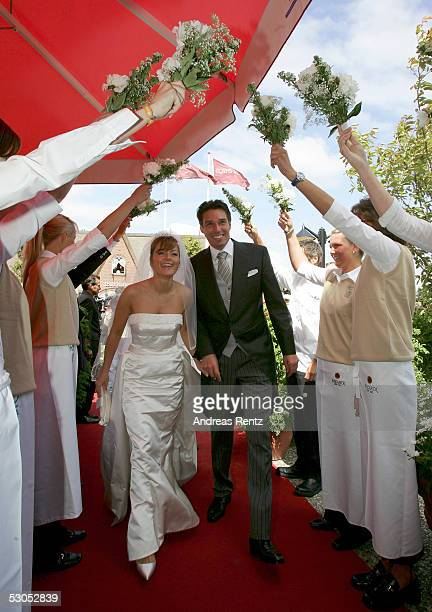 Ex Tennis player Michael Stich and his wife Alexandra Stich maiden name Rikowski pass a flowerarch on the way to the Club Gogaertchen on June 11 2005...