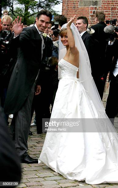 Ex Tennis player Michael Stich and his wife Alexandra Stich maiden name Rikowski pose at the Sankt Severin church on June 11 2005 at Sylt in Germany...