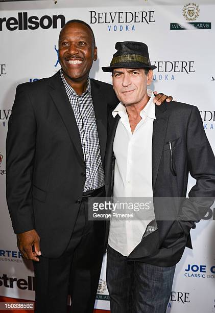 Ex Toronto Blue Jay player Joe Carter and Actor Charlie Sheen attend the Joe Carter Classic After Party to support the Children's Aid Foundation at...