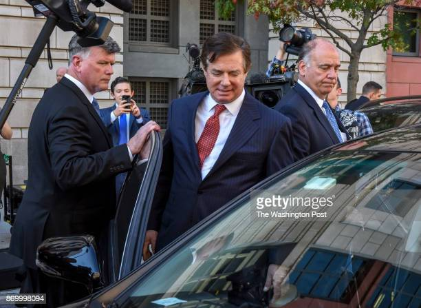 Ex Trump campaign official Paul Manafort center departs US District Court with his attorney Kevin Downing left on November 2017 in Washington DC