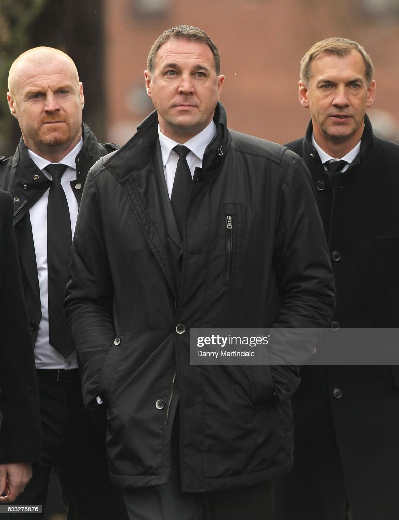 Ex Watford managers Sean Dyche and Malky Mackay attends the funeral of former England football manager Graham Taylor at St Mary's Church on February 1, 2017 in Watford, England. Graham Taylor died on January 12, 2017 from a suspected heart attack.